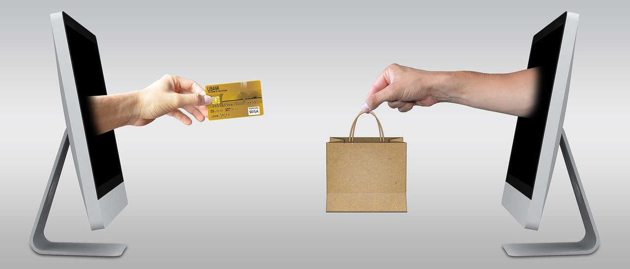 Exchanging a bag with products for a credit card through monitors.